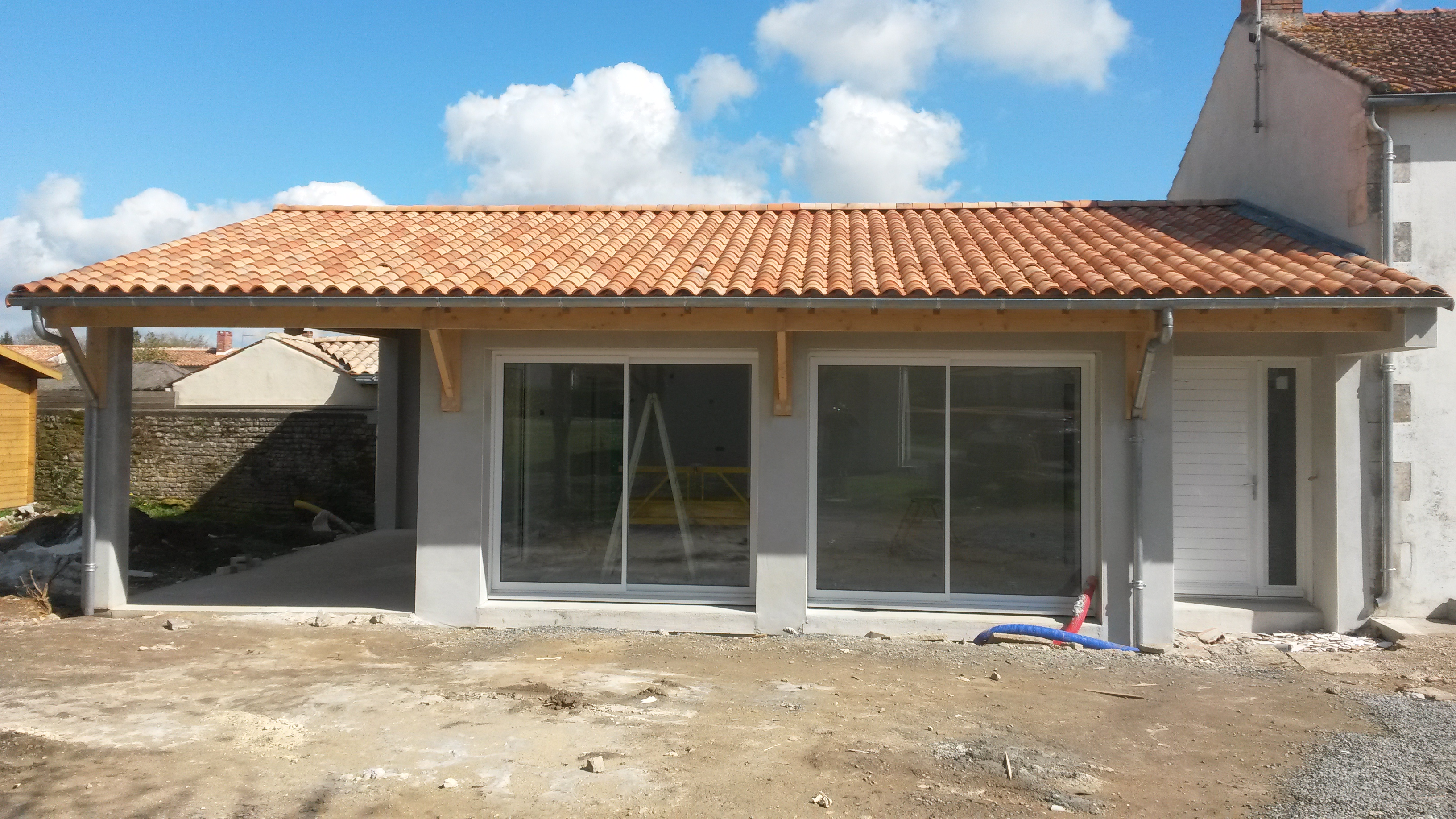 Extension d 39 une maison pete construction for Extension maison 72